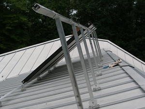 solar collectors on metal roof